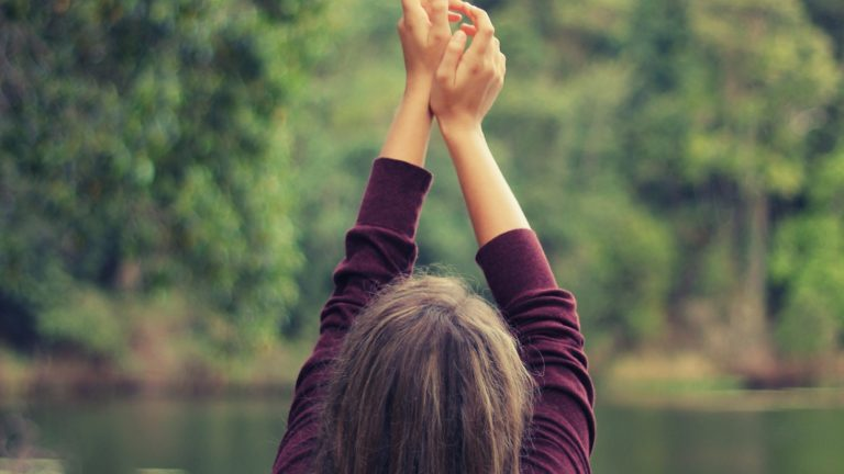 girl with hands up